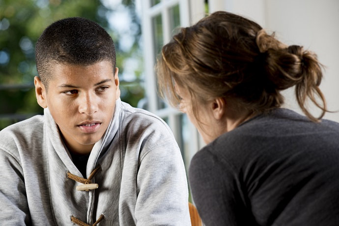 Counselling. Woman talking to a boy