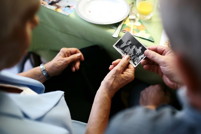 Caring for the elderly. Two people looking at an old photograph