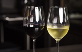 Two glasses of wine on table.
