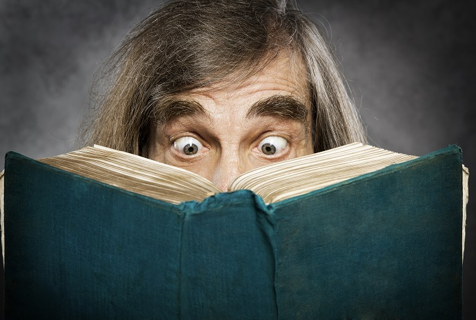 Senior reading open book, suprised old man, amazing eyes looking blank cover
