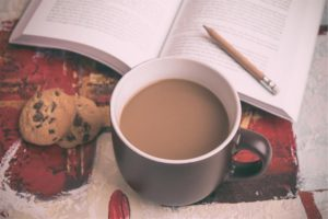 English teacher. Book, mug of tea and cookies