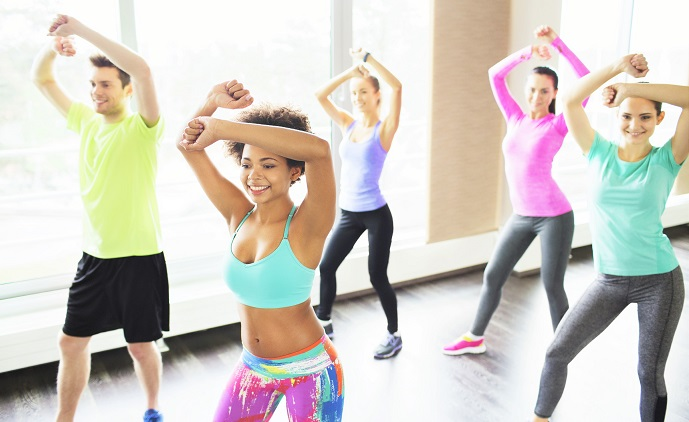 How to become a personal trainer. Woman leading a fitness class.