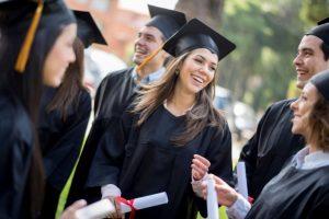 Group of graduates outside university.