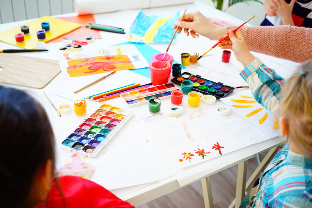 Kids painting in an art class at school