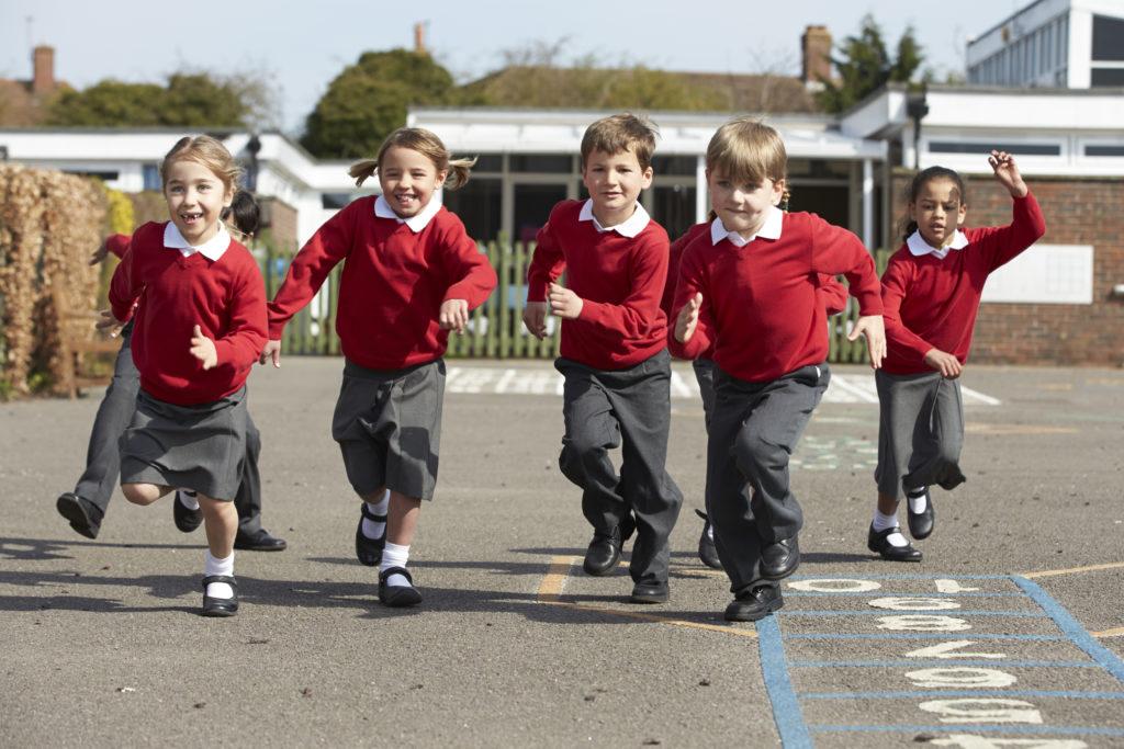 Pupils Running In Playground