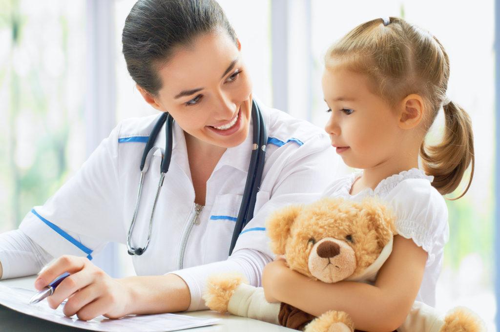 nurse examining a child