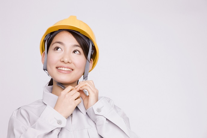 woman wearing a hard hat empowering women