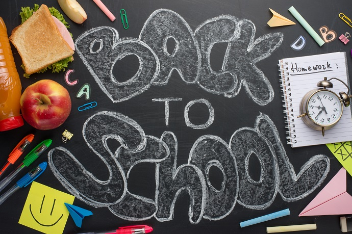 Back to school, the inscription with white chalk on a black school board, with breakfast and chancellery
