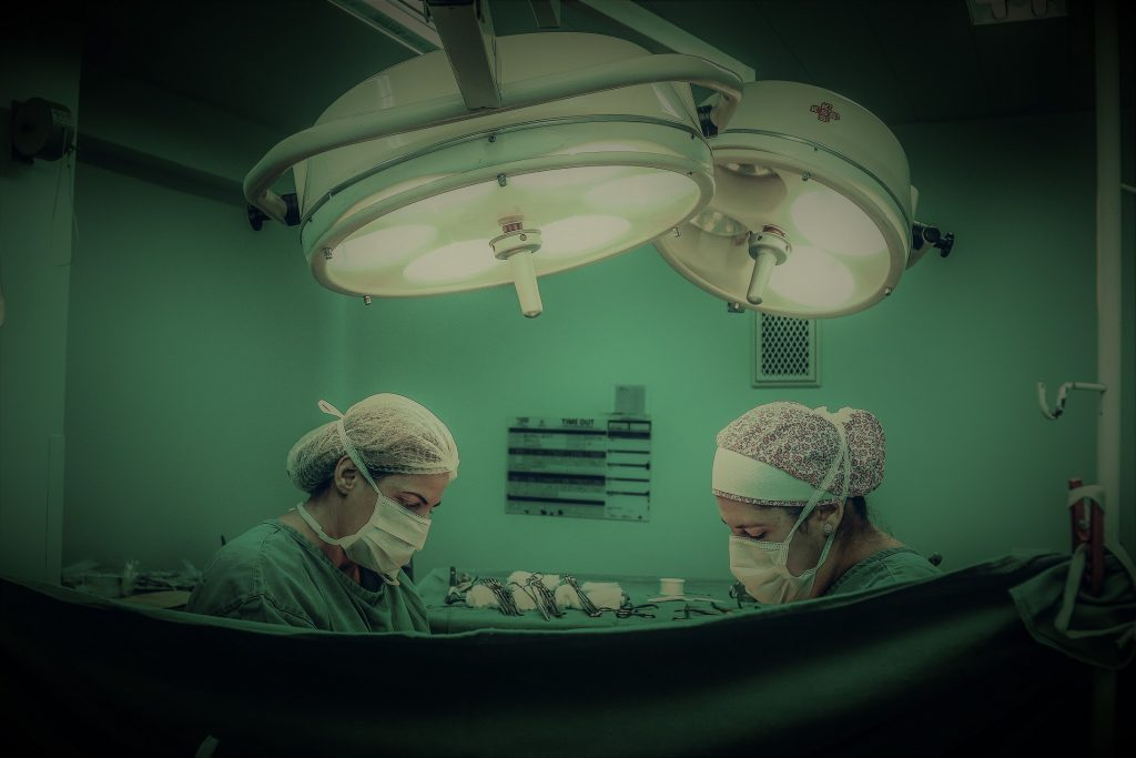 Surgeons in operating theatre in hospital.