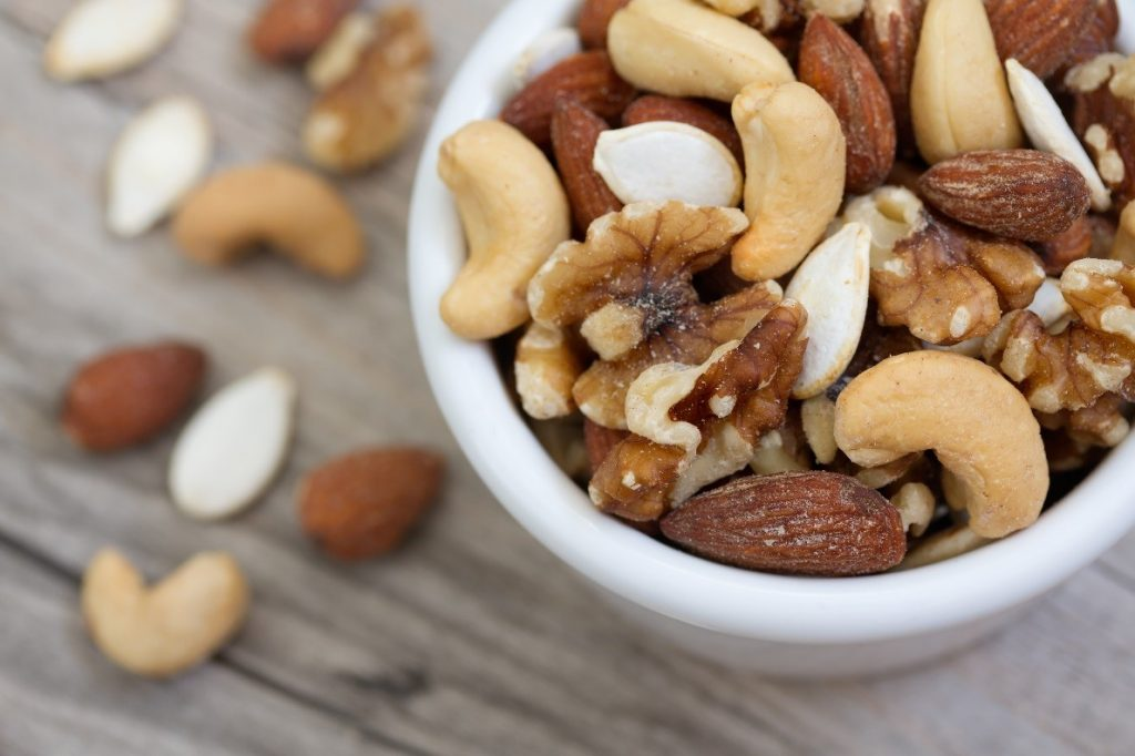 Nuts superfood example: nuts in a white bowl.