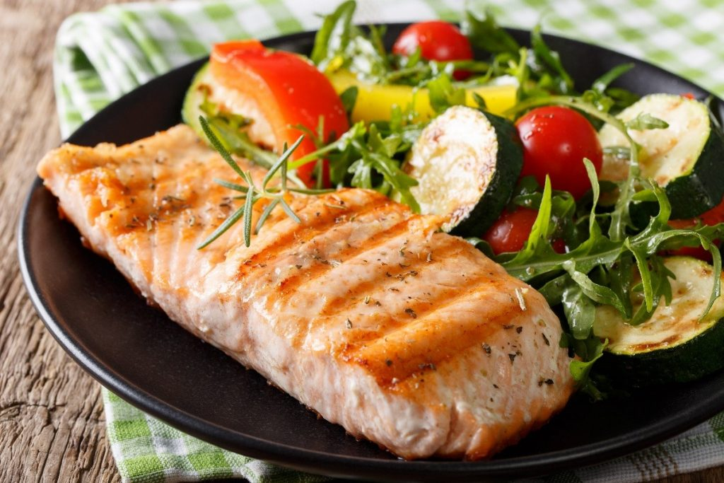 Example of fish superfoods: salmon and med veg on plate.