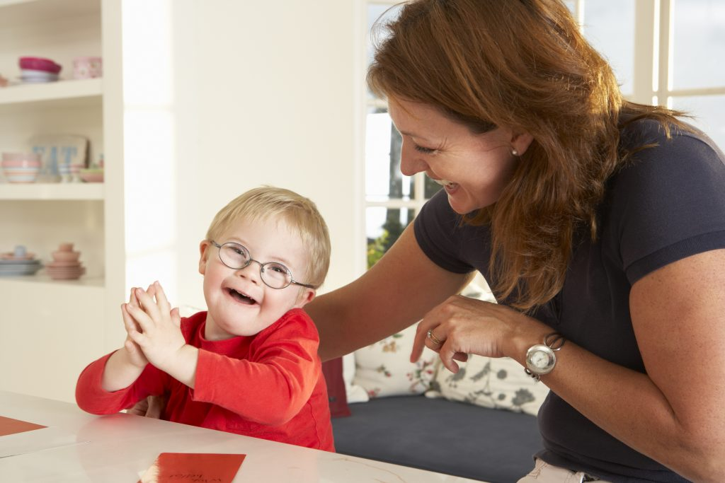 Learning disability (SEN) child with SEN teaching assistant