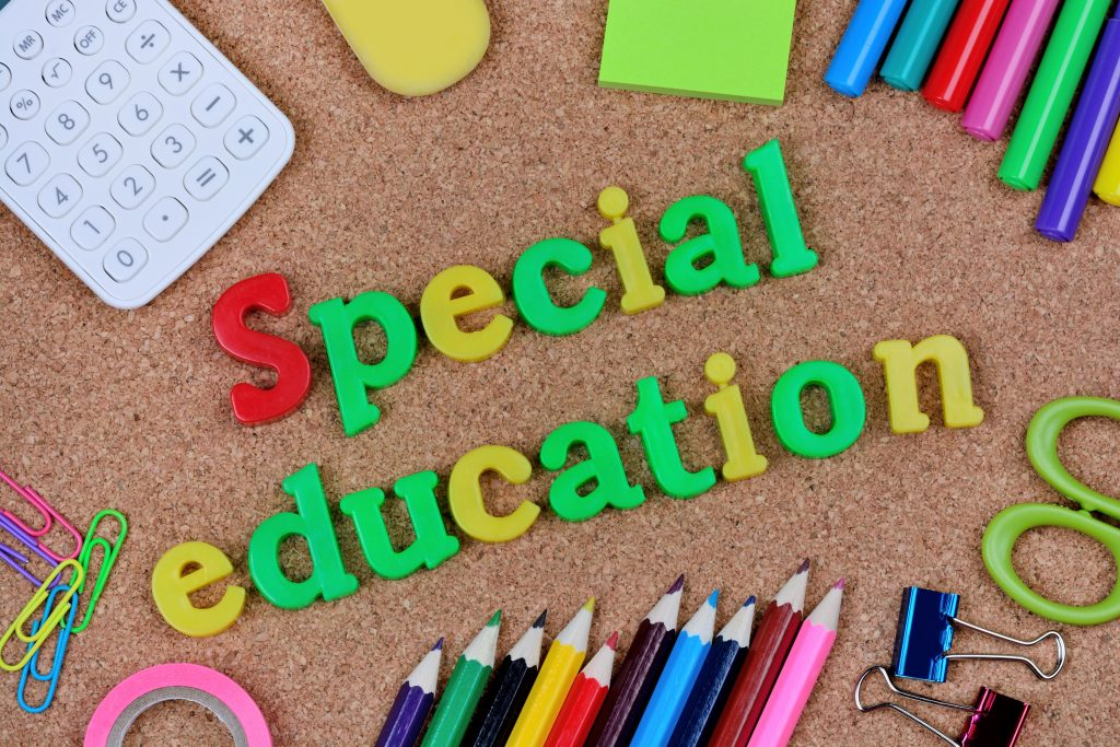 Special education words on cork background to support learning disability.