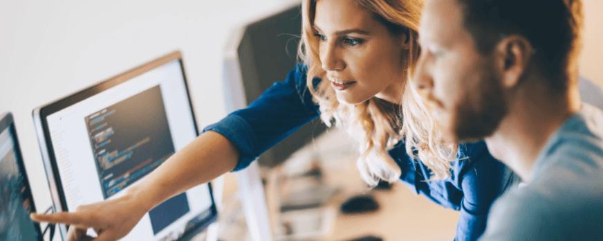 Woman pointing at computer monitor